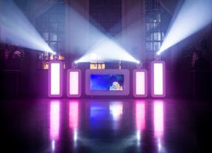 Skyfly Spain DJ booth lit at night