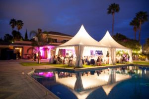 Evening reception in a marquee by a pool