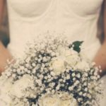 Bride holding a bouquet of white flowers